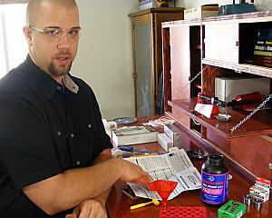 Portrait of Travis Peacock reloading writer