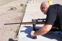 Adjusting shooting stand with Ruger .243 rifle installed